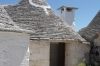 The Trulli, limestone dwellings of Rione Monti, Alberbello.  Some have mythological or religious symbols in white ash on the rooves.