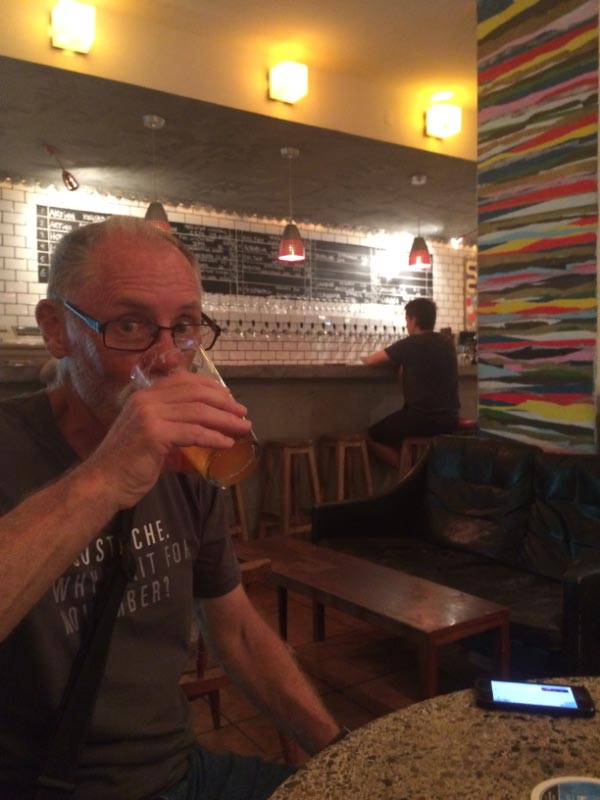 Bruce enjoying a beer at Ol God, next door to our AirBnB