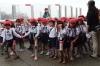 School children line up for their next adventure at Umitamgo (aquarium), Oita, Japan.  Note the shoes.