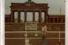"I'm in front of the Brandenburg Gate on W Berlin side. Notice says ""Attention, you are now leaving West Berlin""."