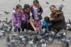 Feeding pigeons in Plaza Bolivar, Bogotá CO
