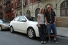 Bruce & Thea with hire car in Harlem, NY. End of the road journey.