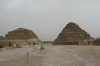 Smaller pyramids of family members of Khufu, beside the first pyramid of Giza