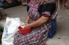Pulling kernal of corn cobs. Moreria Santo Tomas - made by Miguel Ignacio, Chichicastenango GT