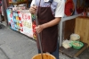 Pounding chilli, ginger and garlic.  The city is famous for spicy food. Ciqikou Ancient Town, Chongqing, China