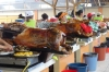 Roast pork is a specialty in the market in Gulaceo EC