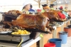 Roast pork is a specialty in the market in Gulaceo EC