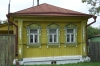 Julia's mother's house, next door - a very typical Russian house, usually 3 windows at the front, a verandah entrance on the side, often very crooked, and always brightly painted. Near Suzdal RU