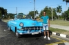 Owen and his 1954 Chevrolet ride through Havana, Havana CU