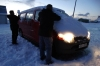 Scraping snow & ice off our van before leaving Vik