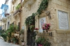 Decorated houses in narrow street in Rabat, Malta