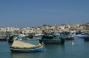 Colourful boats in the harbour of Marsaxlokk, Malta