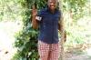 Our guide under a clove tree, Kidichi Spice Farm, Zanzibar Island, Tanzania