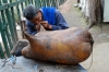 Repairing a raft made from inflated sheep skins, The Watermill Garden, Lanzhou