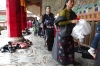 Worshippers arriving at the main prayer hall, Labrang Monastery, Xaihe, Tibet