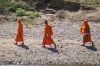 Buddhist monks beside the Nam Khan River, Luang Prabang LA