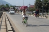 Young girl on bike with umbrella - how elegant!, Luang Prabang LA
