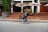 Thea on her blue hire bike, outside our hotel, Luang Prabang LA