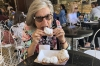 Thea tries a Beignet, speciality of New Orleans LA