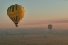 Ballooning over Valley of the Kings, Luxor.  Smoke haze from burning the sugar cane fields after cropping