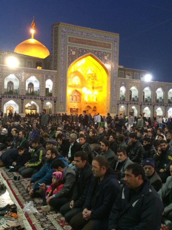 Prayer time for men at the Imam Reza Shrine and major pilgrimage place in Iran