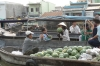 Buying watermelons at the floating market near Can Tho