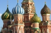 Detail on the onion domes of St Basil's Cathedral in evening sun, Red Square, Moscow RU.