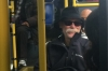 Bruce looking sinister, on the bus down 125th Street, New York
