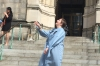 Steph throws her mortar board n front of The Cathedral Church of St. John the Divine, Columbia University, New York