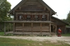 Wooden house - This is a merchant's house with 4 windows across the front, a larger house.  Novgorod's Museum of Wooden Architecture. RU