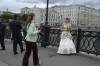 Young, freezing bride on the Luzhkov Bridge. Moscow RU