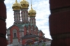 Church domes from the bridge entrance to the Kremlin, between the Kutafya Tower and the Trinity Gate Tower. Moscow RU