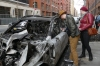 Burnt out cars in New York US (caused by a cigarette thrown into roadside rubbish)