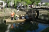 Tourists on the canal in Kurashiki, Japan