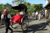 Tourists riding a rickshaw in Kurashiki, Japan