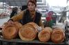 Bread seller. Osh Market