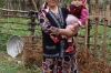 Our hostess and her granddaughter. Home stay, Kojo-Kelen KG