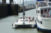 First lock of the Panama Canal.  Catamaran ties up to another tourist boat.