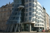 Gehri's Dancing House on the Vltava River in Prague CZ.  Originally named Fred and Ginger (after Fred Astaire and Ginger Rogers) - the house vaguely resembles a pair of dancers