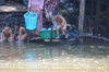 Family bath time in the Siem Reap River