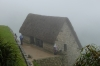Grain storage building. A wet day in Machu Picchu PE