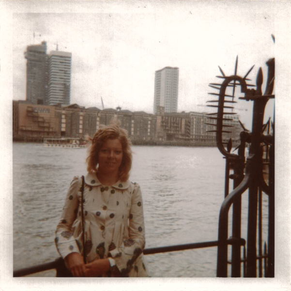 Thea in front of some of the ugly loading docks on the Thames, London, England.