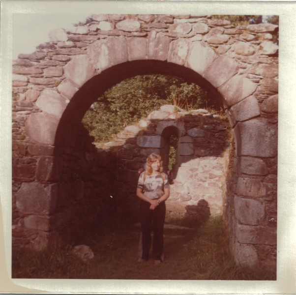 Underneath the arches of the ruins of one of seven churches of Glendlough, Wicklow mountains, Ireland.