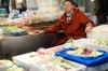 Fish seller, Tsukiji Market, wholesale market specialising in fish, Tokyo, Japan