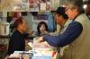 Cashier, Tsukiji Market, wholesale market specialising in fish, Tokyo, Japan