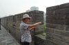 Thea pointing west to the Silk Road from the ancient city wall of Xi'an CN